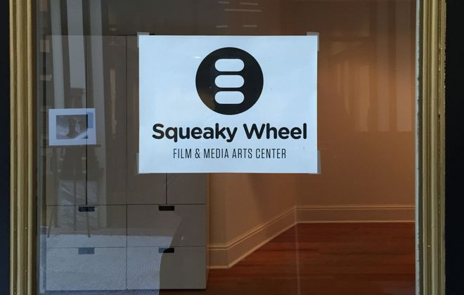 Squeaky Wheel Media has brand-new digs inside the Market Arcade building.