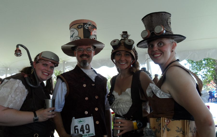 University of Maine Machias alumni, from left, Katie Archambault, Jimmy Kroon, Kathleen Kulig and Lori Brown make a weekend of the Dogfish Dash, and are among those who show up in costume. (Scott Scanlon)
