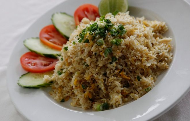 Featuring jasmine rice, crabmeat, eggs, onions and scallions with vegetable garnish. (Sharon Cantillon/Buffalo News)