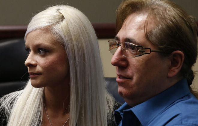 Vanessa DeRosa, 25, and Tino Flores, 51, who claim they were sexually abused by representatives of the Buffalo Diocese are trying to reach  out to Pope Francis to investigate the Diocese of Buffalo's handling of sexual abuse complaints.  They had a press conference at Hogan Willig law offices in Amherst onTuesday, Jan. 27, 2015.  (Robert Kirkham/Buffalo News)