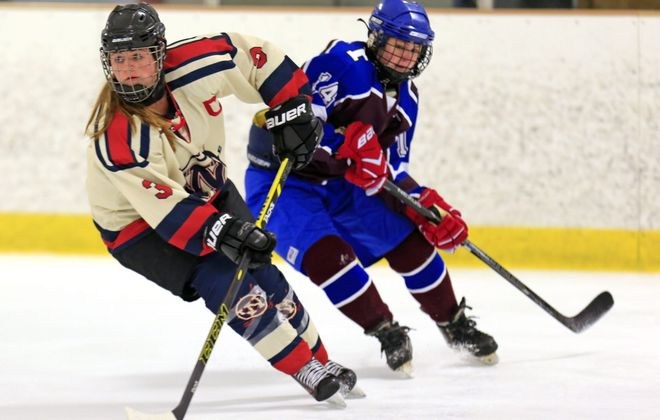 Jordan Roetzer (3) of Williamsville brings the puck up ice aganst Frontier/Orchard Park at the Northtown Center.
