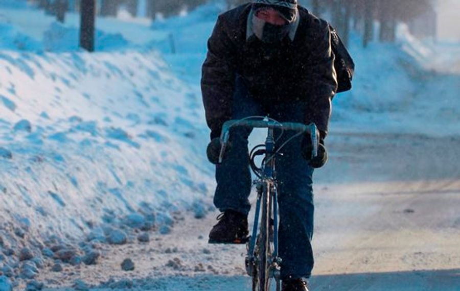 Matt Cuciti of Highland, N.Y., an MBA engineering major, rides his bike to class at the UB North campus, in Amherst, N.Y., on Thursday, Feb. 19, 2015.    (John Hickey/Buffalo News)