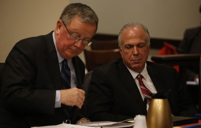 """Attorney Richard T. Sullivan, left, and  Dr. James G. Corasanti as opening statements are presented in the  wrongful-death lawsuit against Corasanti by Alexandria """"Alix"""" Rice's parents Richard J. Rice and Tammy A. Schueler at the Erie County Courthouse in Buffalo on Monday.    (John Hickey/Buffalo News)"""