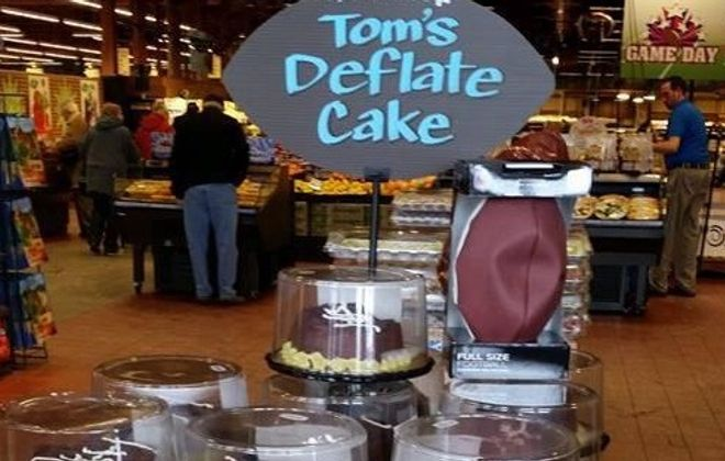 Wegmans is selling these Tom's Deflate Cakes leading up to the Super Bowl. (Via Twitter user @Deno716)