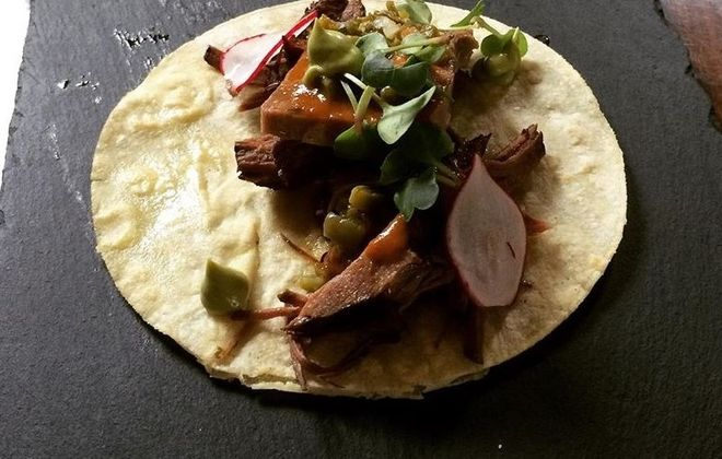 Braised short rib barbacoa topped with lengua, or tongue, with roasted tomato salsa (Photo: Victor Parra Gonzalez)
