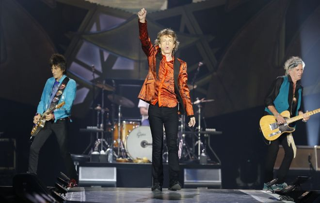Mick Jagger, middle, led the way for The Rolling Stones at New Era Field in 2015. (Harry Scull Jr./News file photo)