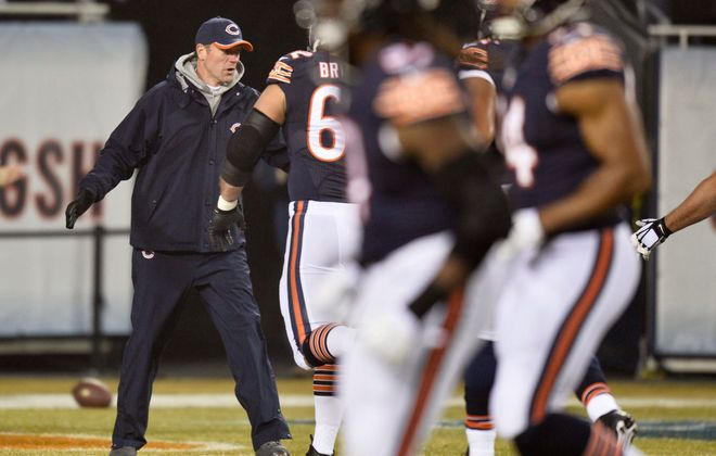 CHICAGO, IL - DECEMBER 15: Offensive coordinator Aaron Kromer of the Chicago Bears greets players on the field before a game against the New Orleans Saints at Soldier Field on December 15, 2014 in Chicago, Illinois. (Photo by Brian Kersey/Getty Images)