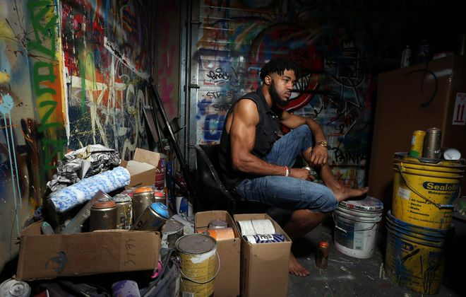 "Aaron Maybin, photographed in his Baltimore studio, is proud that he made enough money during four years in the NFL to retire his folks to South Carolina. ""My family wanted out, and through football, they got out."" (James P. McCoy/Buffalo News)"