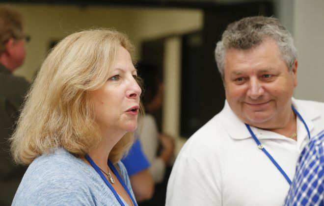 Margie and Milan Suga of Manhasset, NY and parents of an incoming UB freshman on the north campus for orientation in Amherst Monday, July 20, 2015.    (Mark Mulville/Buffalo News)