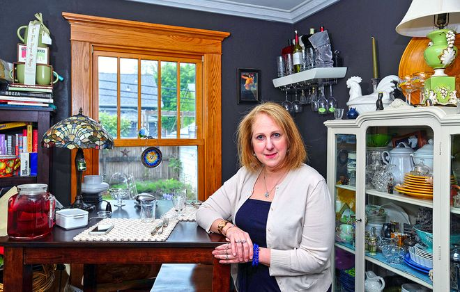 Donna Rautenstrauch has outfitted much of her Northtowns home with estate sale finds; she says the quality is usually much better than current goods made in China.