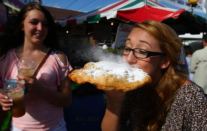 Fried dough at lawn fetes, carnivals and festivals all over Western New York is a premier summer comfort food. (John Hickey/Buffalo News file photo)