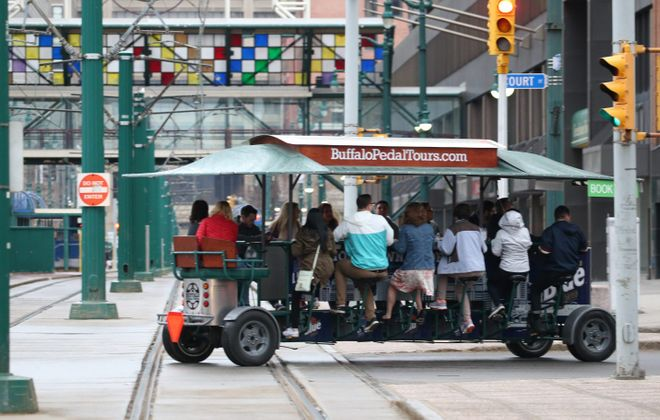 Buffalo Pedal Tours runs a downtown Buffalo bar tour in the pub crawler which is an open-air limo pedal-powered by the riders and driven by owner Ken Szal. (Sharon Cantillon/Buffalo News)