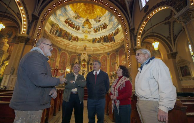 """With """"Disputa"""" mural as backdrop, art restorer Henry Swiatek, left, and fellow Friends of Corpus Christi leaders – from second left, Thaddeus Fyda, Martin Ederer and wife and President Lucia Ederer, and William Koch – discuss grass-roots restoration of church."""