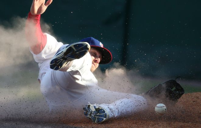 The Bisons' Brad Glenn makes a diving attempt but drops a fly ball in foul territory in the second inning at Coca-Cola Field.