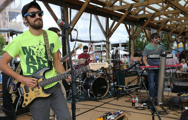 Aqueous lead guitarist Mike Gantzer performs at Larkin Square in July 2014. His band takes over Buffalo Iron Works this weekend. (Buffalo News file photo)