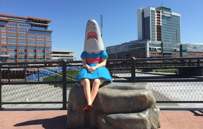 "Casey Riordan Millard's sculpture ""Shark Girl"" has returned to a new spot at Canalside after some conservation work."