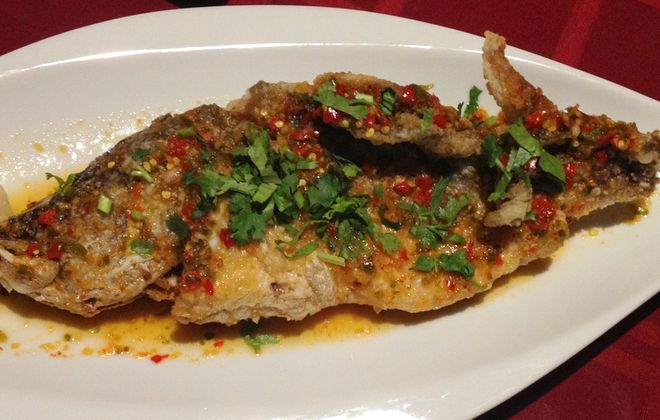 Wok-fried bass with Burmese chile-garlic-lime sauce at Lin Restaurant. (Andrew Galarneau/Special to the  News)