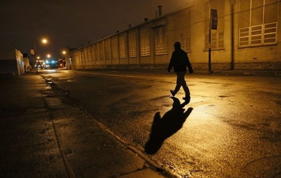Curtis Flakes walks to work on Grider Street, where his shift starts at 5:30 a.m.  Derek Gee/Buffalo News