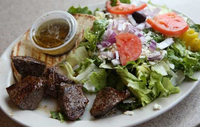 The open beef souvlaki is one of the Greek specialties served at Olympia Grill in Getzville. (Sharon Cantillon/Buffalo News)
