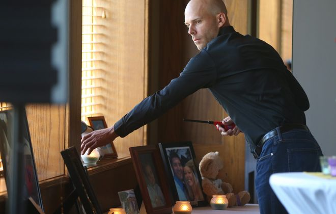 Former Bills punter Brian Moorman lights candles for children and young adults lost to cancer during a Service of Hope at Holiday Valley in Ellicottville on Sunday.