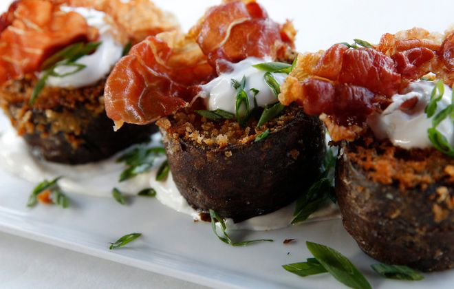 Bacchus' creative take on potato skins features gorgonzola, green onion and crispy prosciutto.  (Sharon Cantillon/Buffalo News)