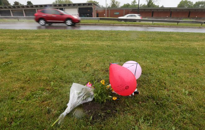 A roadside memorial marks the spot in Delaware Park where a car struck and killed Maksym Sugorovskiy, 3, Saturday.