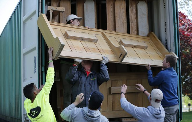 Students from Canisius High School and volunteers from OSC help move the pews out of the former chapel of the Franciscan Sisters of St. Joseph in Hamburg and load them into trucks so they can be shipped to Nicaragua to be repurposed by the NIcaragua Mission Project, Friday, May 22, 2015.  (Derek Gee/Buffalo News)