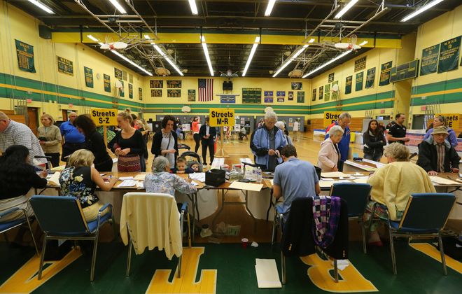 Voters line-up during voting in the gym at Williamsville North high school Tuesday, May 19, 2015.    (Mark Mulville/Buffalo News)