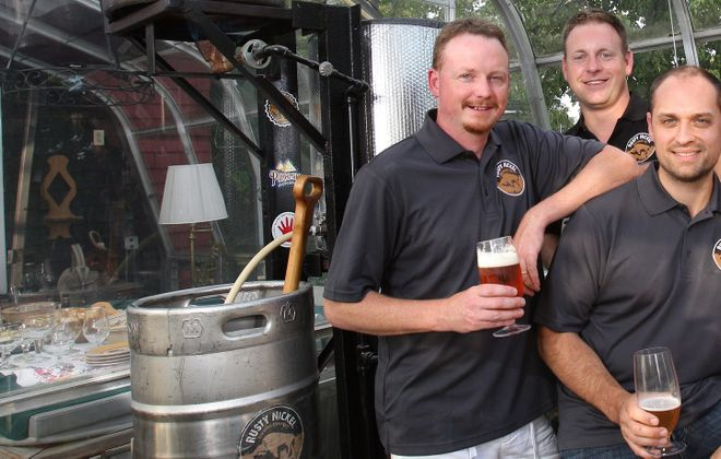 From left, Rusty Nickel Brewing Co. owners Dave Johnson, Jason Havens and Scott Fiege. (Sharon Cantillon/Buffalo News)