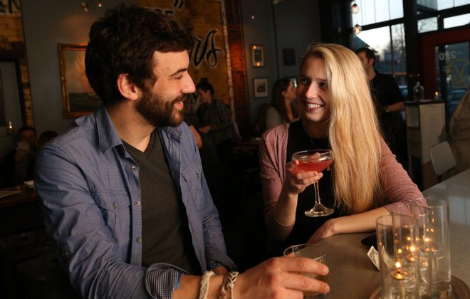 Tyler Samer, left, of Cheektowaga, and Chelsea O'Donnell, of Buffalo, enjoy cocktails at the bar at Vera Pizzeria. (Sharon Cantillon/Buffalo News)