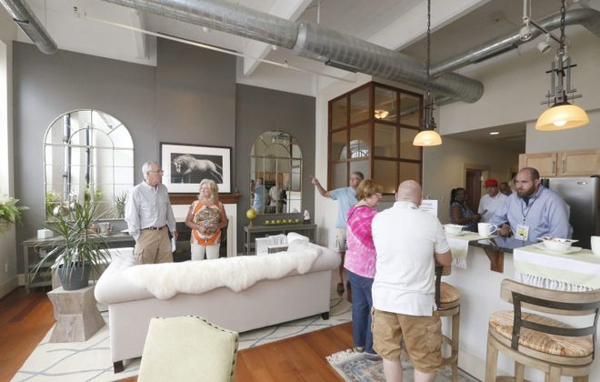 Participants enjoy seeing new apartment properties on a previous version of the annual Buffalo Living Tour. (Robert Kirkham/News file photo)