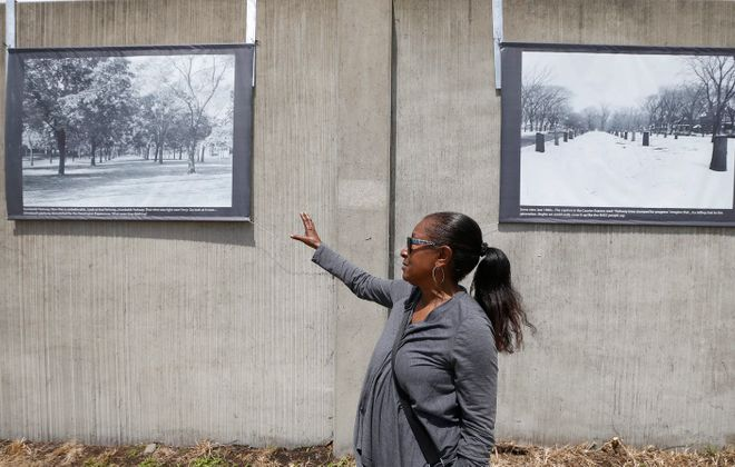 Ellen Lucas discusses before-and-after photos of her lawn when West and East Ferry were bisected by the 33. (Robert Kirkham/Buffalo News)