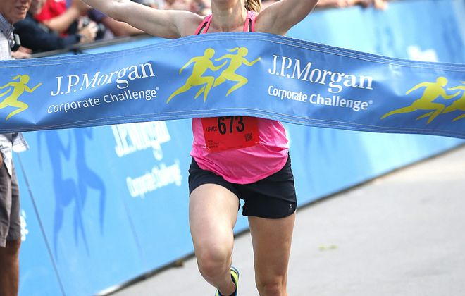 Top women's finisher Mary Giza of Lancaster crosses the finish line with a time of 20 minutes, 55 seconds at the J.P. Morgan Corporate Challenge.