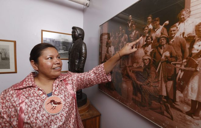 Robert Kirkham/Buffalo NewsRebecca Parker points to a relative in a photo inside the Tonawanda Indian Community House. Parker is a Seneca who supports Newstead's decision to designate the first Monday in October as Indigenous Peoples Day.
