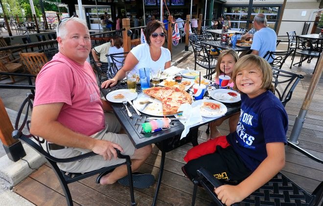 Don and Kristen Kusz and their children Madison and Colin enjoy dinner at Santora's Pub and Grille on Transit Road in WIlliamsville. (Harry Scull Jr./Buffalo News)