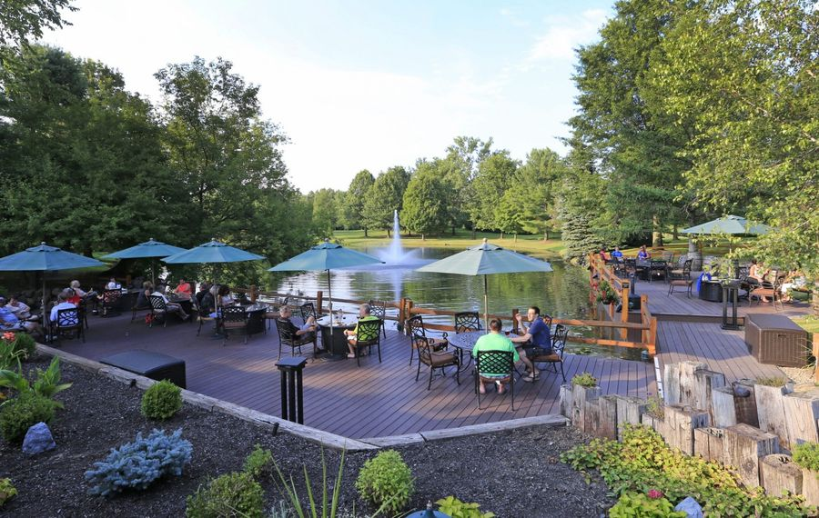 Hamburg Brewing's patio overlooks perfectly manicured grounds and a pond with a fountain. (Harry Scull Jr./Buffalo News)