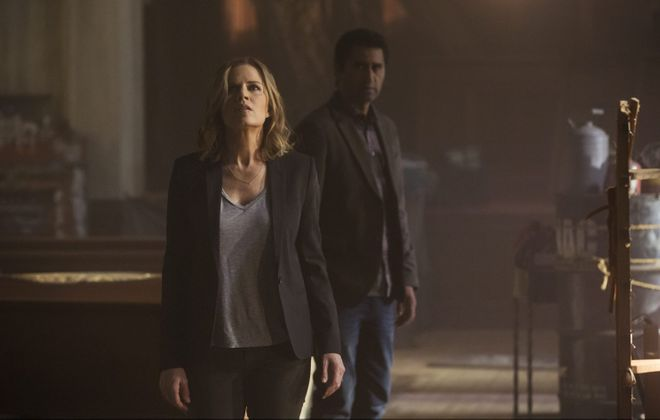 """Madison (Kim Dickens) and Travis (Cliff Curtis) discover something is terribly wrong inside an abandoned church in the new AMC series """"Fear the Walking Dead."""""""
