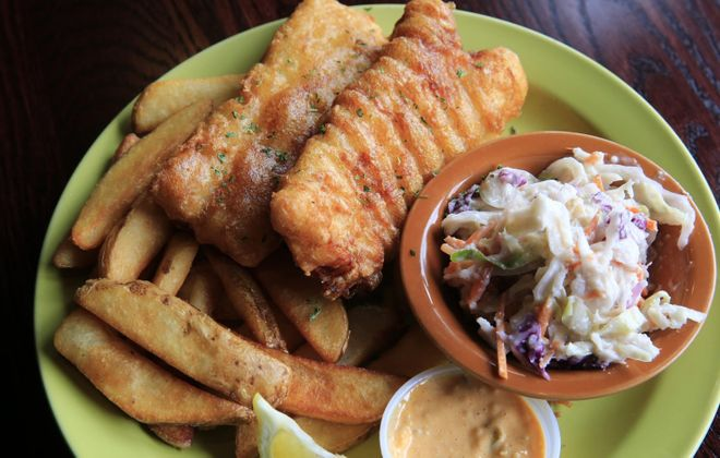 Hand beer-battered fish served with English chips, jalapeno-apple coleslaw and sriracha tartar sauce from Tavern at Windsor