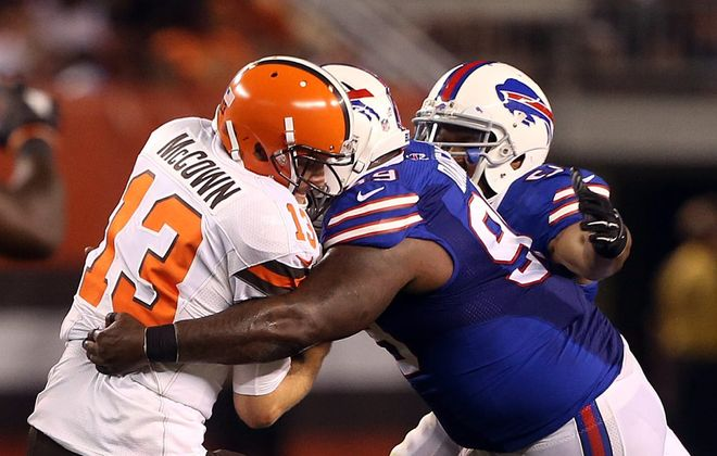 Browns quarterback Josh McCown gets sacked by Bills defensive tackle Marcell Dareus in the first half of Thursday's game.