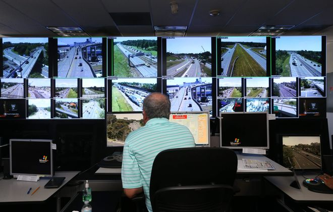 Traffic management operation technician Bill Conway monitors traffic flow at the NITTEC center. Data indicate that summer commute lengths to downtown decrease notably in summer due to school vacations and other factors.