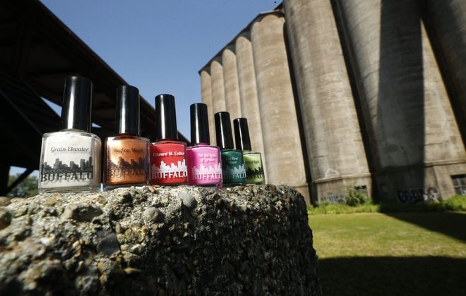 Lisa Menchetti creates nail polishes in colors inspired by Buffalo, including this grouping photographed in front of the Perot Malting Elevator at Silo City.