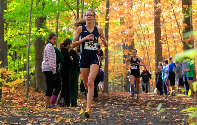 Sophia Tasselmyer  makes her way through the woods on her home course in winning last year's ECIC title. (Harry Scull Jr./Buffalo News)