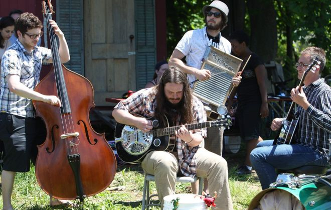 Buffalo band Folkfaces, performing above at the 2014 Artfarms, is one of Mike Farrell's featured shows this weekend.  (Sharon Cantillon/Buffalo News file photo)