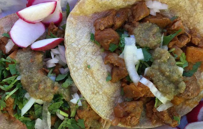 Dressed al pastor (pork and pineapple) tacos at La Divina. (Andrew Galarneau/Buffalo News)