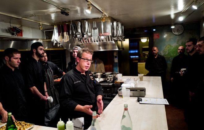 Chef Adam Goetz holds a meeting with his team before beginning the preparations for dinner at the James Beard House in Manhattan on September 15, 2015. (Andrew Renneisen for The Buffalo News)