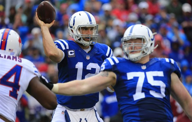 Andrew Luck was hassled by the Bills defense all game. (Harry Scull Jr./Buffalo News)