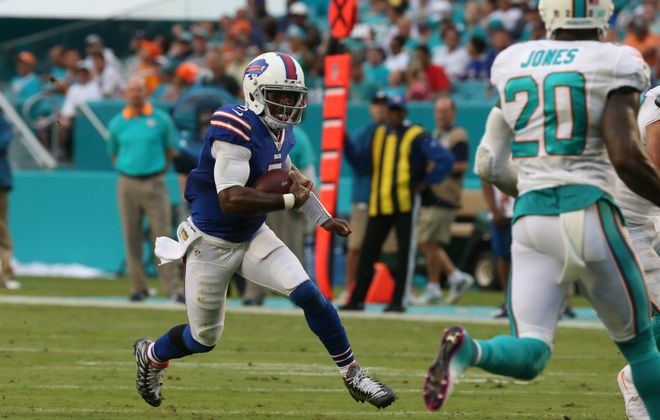 Buffalo Bills quarterback Tyrod Taylor (5) runs the ball during the first half at the Miami Dolphins on Sept. 27.  (James P. McCoy/ Buffalo News)