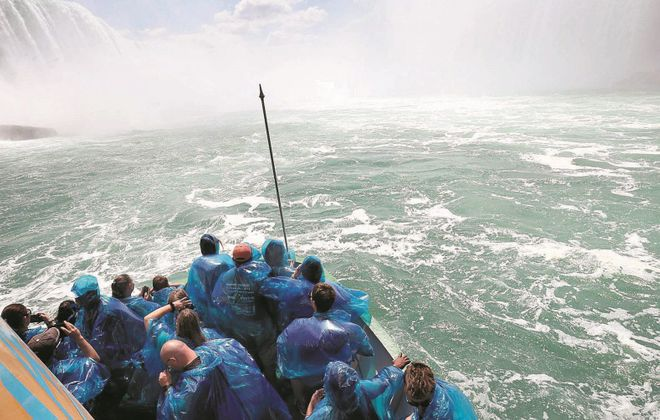 The Maid of the Mist carries sightseers towards the base of Niagara Falls.  (File photo/Sharon Cantillon/Buffalo News)