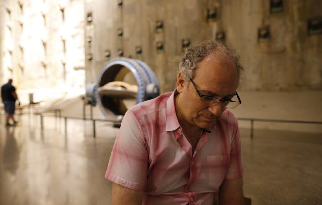Charles Wolf, whose wife, Katherine, was killed in the 9/11 terrorist attacks on the World Trade Center, stops to reflect on his loss in the Foundation Hall at the National September 11 Memorial & Museum in New York City last month.