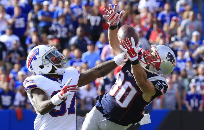 Danny Amendola makes a big catch over Nickell Robey in the fourth quarter. (Harry Scull Jr./Buffalo News)